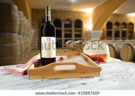 wooden desk and bottle of wine  - stock photo