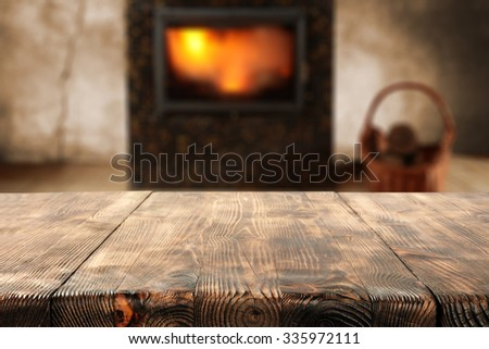 wooden desk and fire  - stock photo
