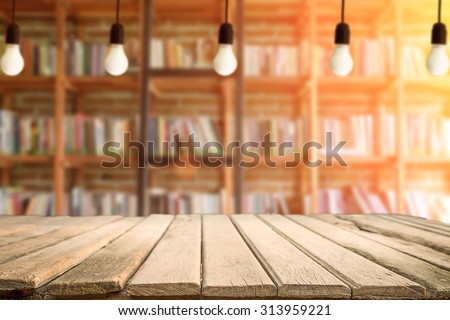 wooden desk free space and library background for presentation product - stock photo