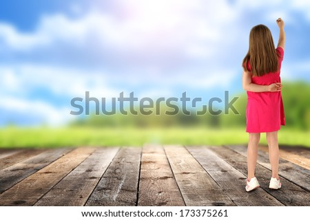 wooden desk girl in red and landscape  - stock photo