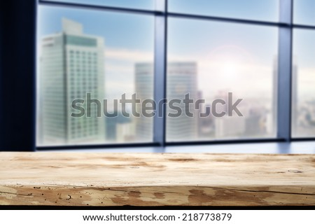 wooden desk of brown and window with city  - stock photo