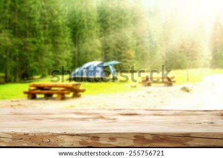 wooden desk space and camping  - stock photo