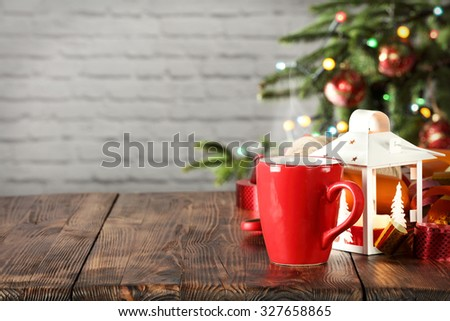 wooden desk space red mug and xmas tree  - stock photo