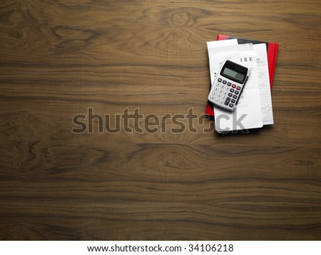 wooden desktop with calculator - stock photo