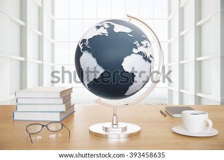 Wooden desktop with globe, coffee, books and glasses on white background - stock photo