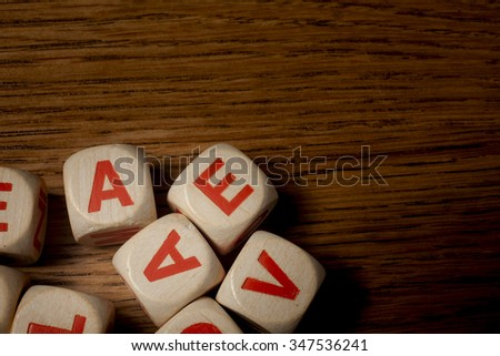 wooden dice letters - stock photo