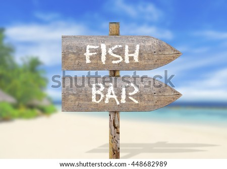 Wooden direction sign with fish bar - stock photo