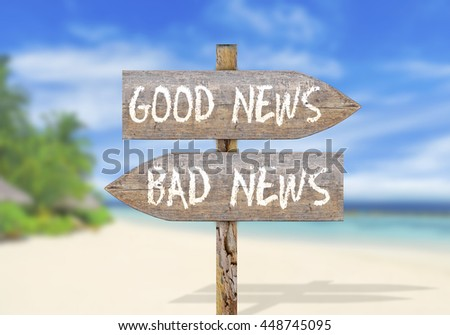 Wooden direction sign with good and bad news - stock photo