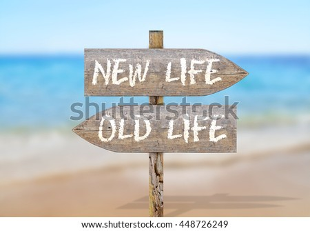 Wooden direction sign with old and new life - stock photo