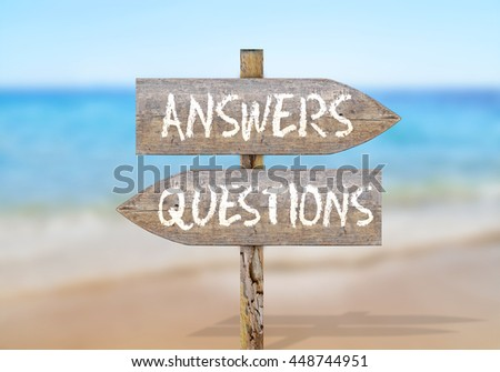 Wooden direction sign with questions and answers - stock photo