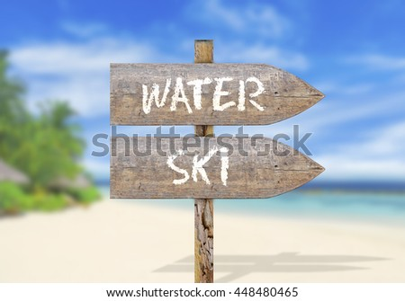 Wooden direction sign with water ski - stock photo