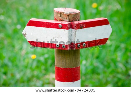 Wooden directional sign pointing to left and right - stock photo