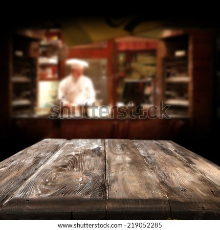 wooden dirty table in restaurant  - stock photo