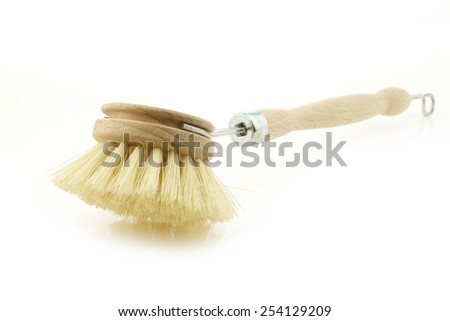 wooden dish washing brush on a white background - stock photo