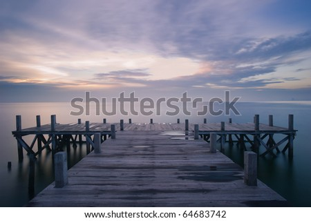 wooden dock early morning - stock photo