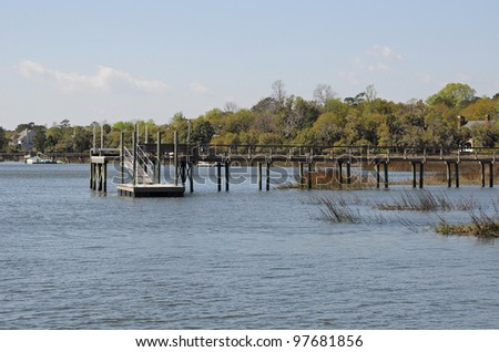 Wooden dock on a river in the Lowcountry of South Carolina - stock photo