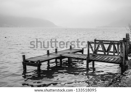 Wooden dock on the lake of Annecy, France (Black and white)
