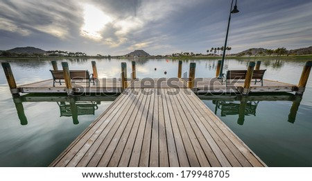 Wooden dock on the small pond - stock photo
