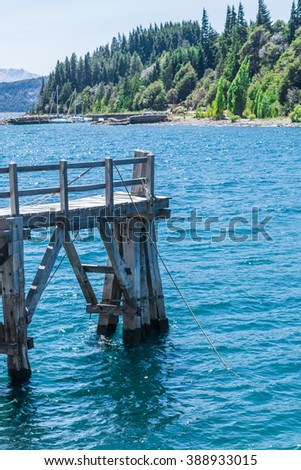 Wooden dock over forest and mountains