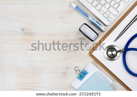 Wooden doctor desk with copy space - stock photo