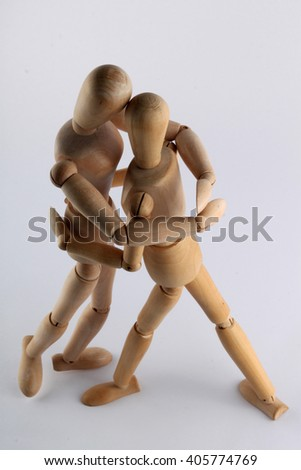 Wooden doll with joints in different positions suggestive actions, activities and characteristics of human attitudes.