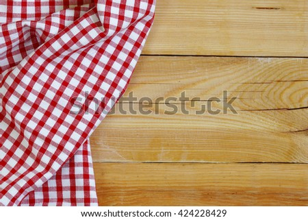 wooden domestic background with checkered kitchen towel, napkin  - stock photo
