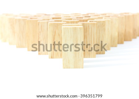 Wooden Domino in row against the white background - stock photo