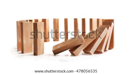 Wooden dominoes on light background