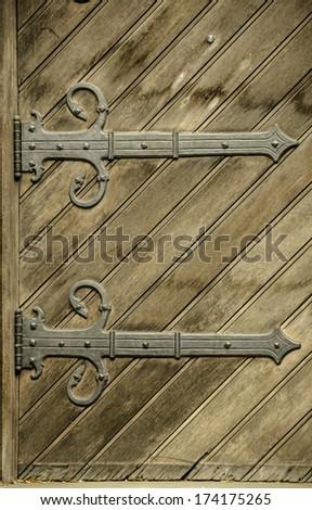 Wooden door and two hinges - stock photo