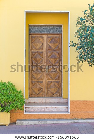 Wooden door. Entrance to the house