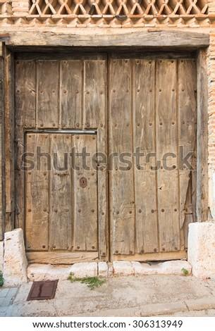 wooden door garage access - stock photo
