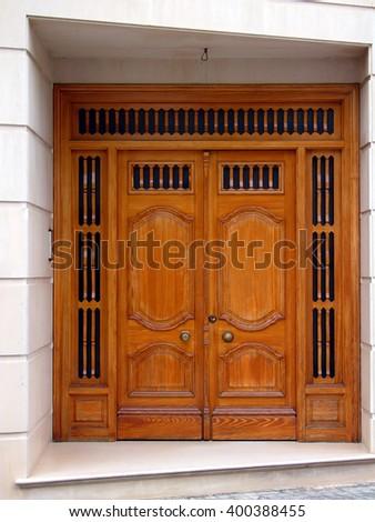 Wooden door in spanish country - stock photo