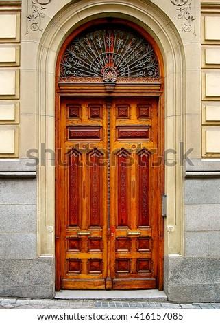 Wooden door in the street of Madrid, Spain - stock photo