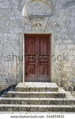 Wooden door in the temple - stock photo