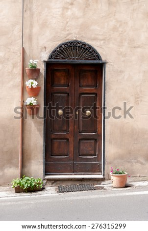 wooden door in the town of Pitigliano - stock photo