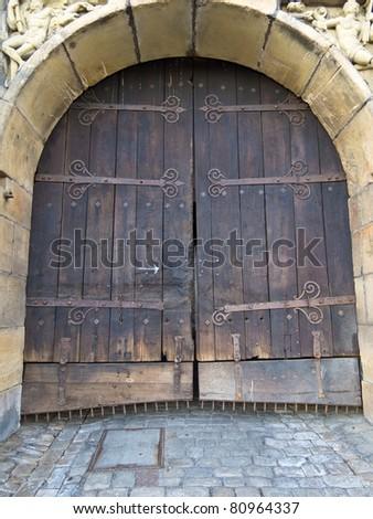 Wooden door of a castle - stock photo
