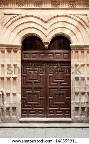 Wooden door of the convent of Holy Trinity (convent de la Trinidad) in Salamanca, Spain - stock photo