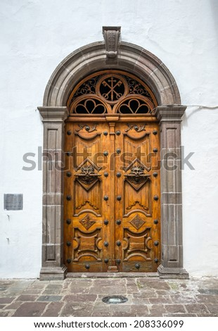 Wooden door of the Sagrario church in Quito, Ecuador - stock photo