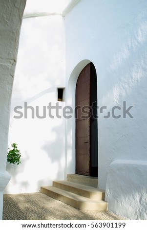 Wooden door, old church, sunny day