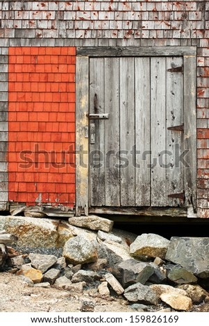 Wooden door on the old house in Peggys Cove, Nova Scotia - stock photo