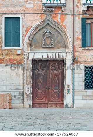 wooden door with artistic decoration in Venice, Italy