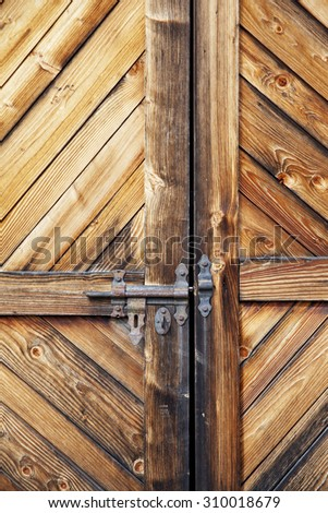 wooden door with bolt. Beautiful wood texture. - stock photo