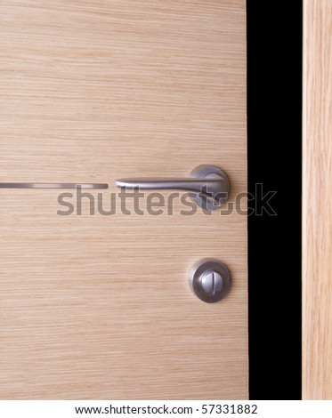 Wooden door with metal handle