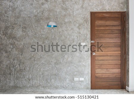 Wooden door with retro lamp decoration in modern room interior
