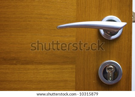 Wooden door with the lock - stock photo