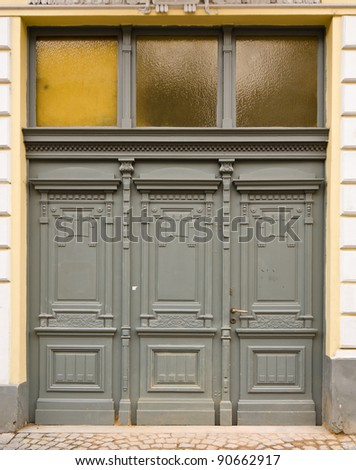 Wooden Door with 3 Wings and Glass Panes, Prague, The Czech Republic - stock photo