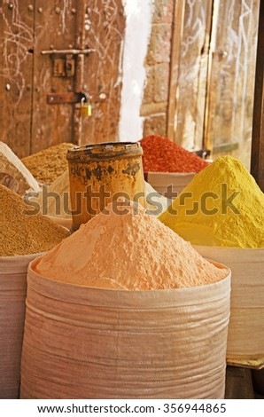 Wooden doors and bags of spices, saffron, in the salt market of the Old City of  Sana'a, suq, Yemen, daily life - stock photo
