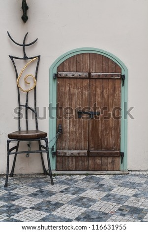 wooden doors and chain tied big chair - stock photo