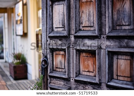 Wooden doors, blackened by the wind from the sea - stock photo