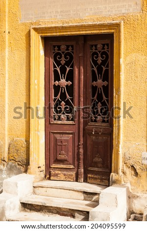 Wooden doors leading into crypt in the Greek Orthodox cemetery in Convent of St George in Coptic or Old Cairo in Egypt - stock photo